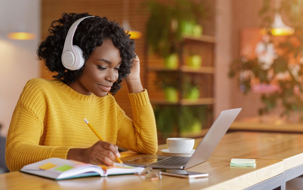 a student studies an online course on your laptop